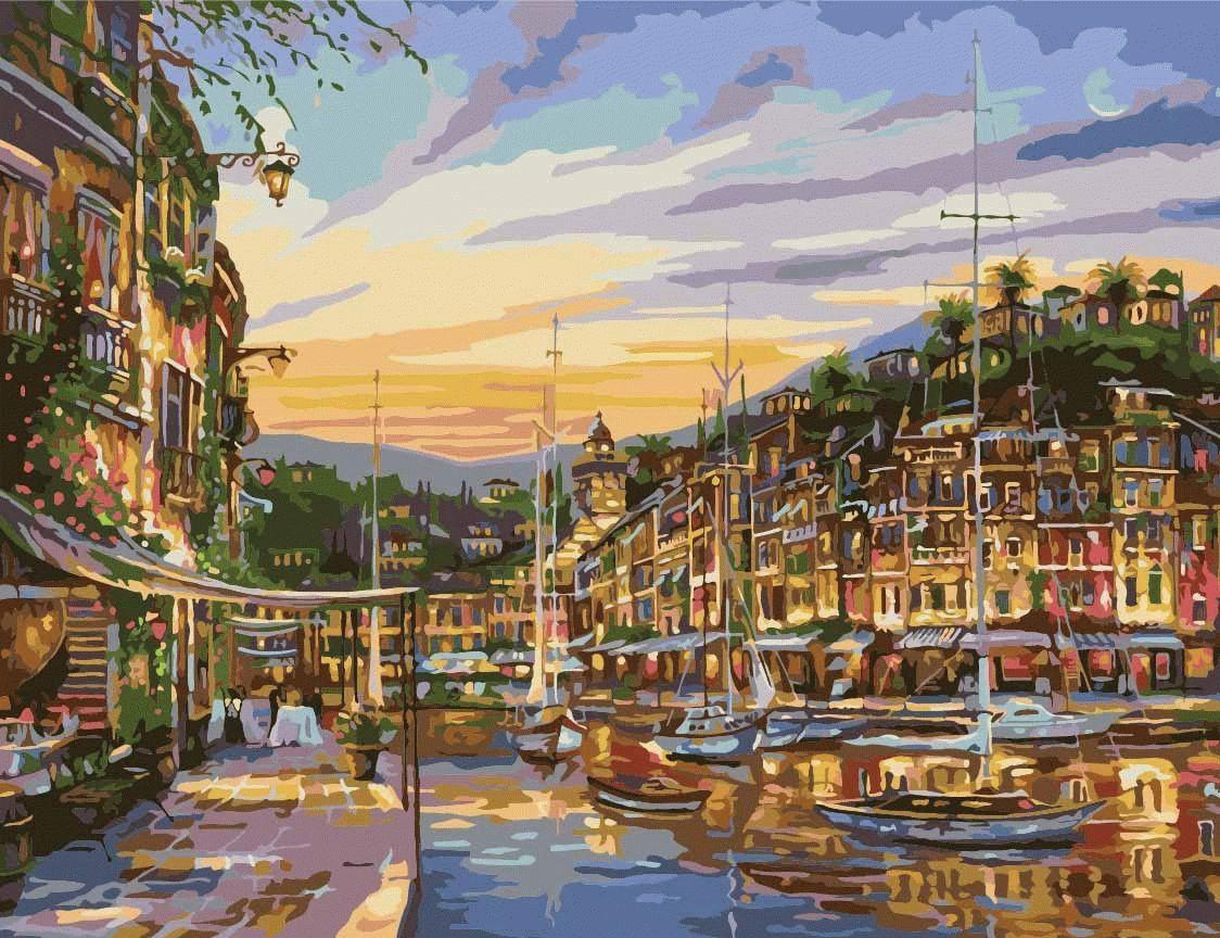 """Картина по номерам «Сказочный вечер» Роберта ФайнэлаЦветной (Premium)<br>Красота морского побережья в Портофино завораживает и остается в памяти навсегда, особенно, когда это любимый курорт, на который хочется возвращаться каждый год, чтобы набраться впечатлений и сил. Картина по номерам """"Сказочный вечер"""" поможет воспоминаниям...<br><br>Артикул: MMC016_Z<br>Основа: Холст<br>Сложность: сложные<br>Размер: 50x65 см<br>Количество цветов: 25<br>Техника рисования: Без смешивания красок"""