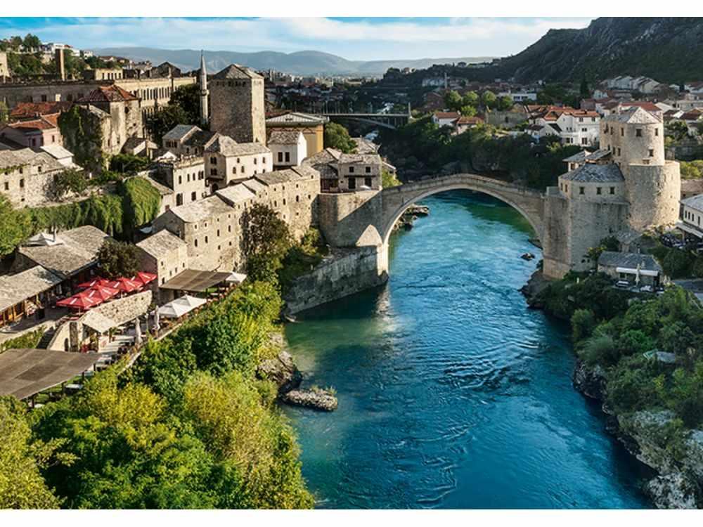 Пазлы «Старый мост в городе Мостар, Босния и Герцеговина»Trefl<br>Пазл - игра-головоломка, мозаика, состоящая из множества фрагментов, различающихся по форме.<br> По мнению психологов, игра в пазлы способствует развитию логического мышления, внимания, воображения и памяти. Пазлы хороши для всех возрастов - и ребенка-дошко...<br><br>Артикул: 10383<br>Размер: 68,3x48 см