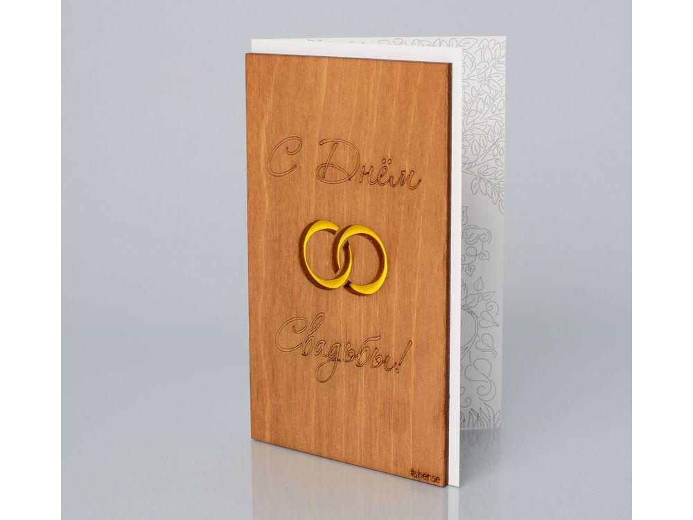 Открытка «С днем свадьбы! (Кольца)»Деревянные открытки<br>Деревянные открытки и денежные конверты - прекрасная возможность сделать яркий подарок для тех, кто ценит оригинальность, однако не забывает о традициях. И креативность такого презента заключена не только в необычной деревянной первой странице, ведь в...<br><br>Артикул: 156<br>Размер: 160 х 106 мм<br>Материал: Дерево, бумага