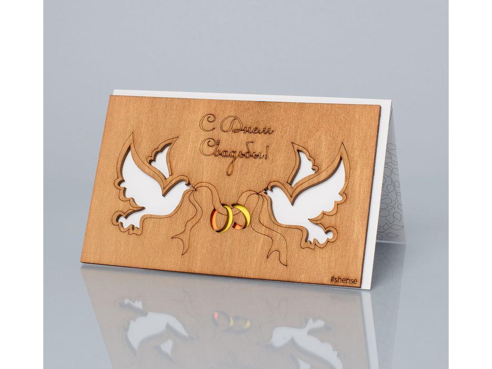 Открытка «С днем свадьбы! (Голуби и кольца)»Деревянные открытки<br>Деревянные открытки и денежные конверты - прекрасная возможность сделать яркий подарок для тех, кто ценит оригинальность, однако не забывает о традициях. И креативность такого презента заключена не только в необычной деревянной первой странице, ведь в...<br><br>Артикул: 158<br>Размер: 160 х 106 мм<br>Материал: Дерево, бумага