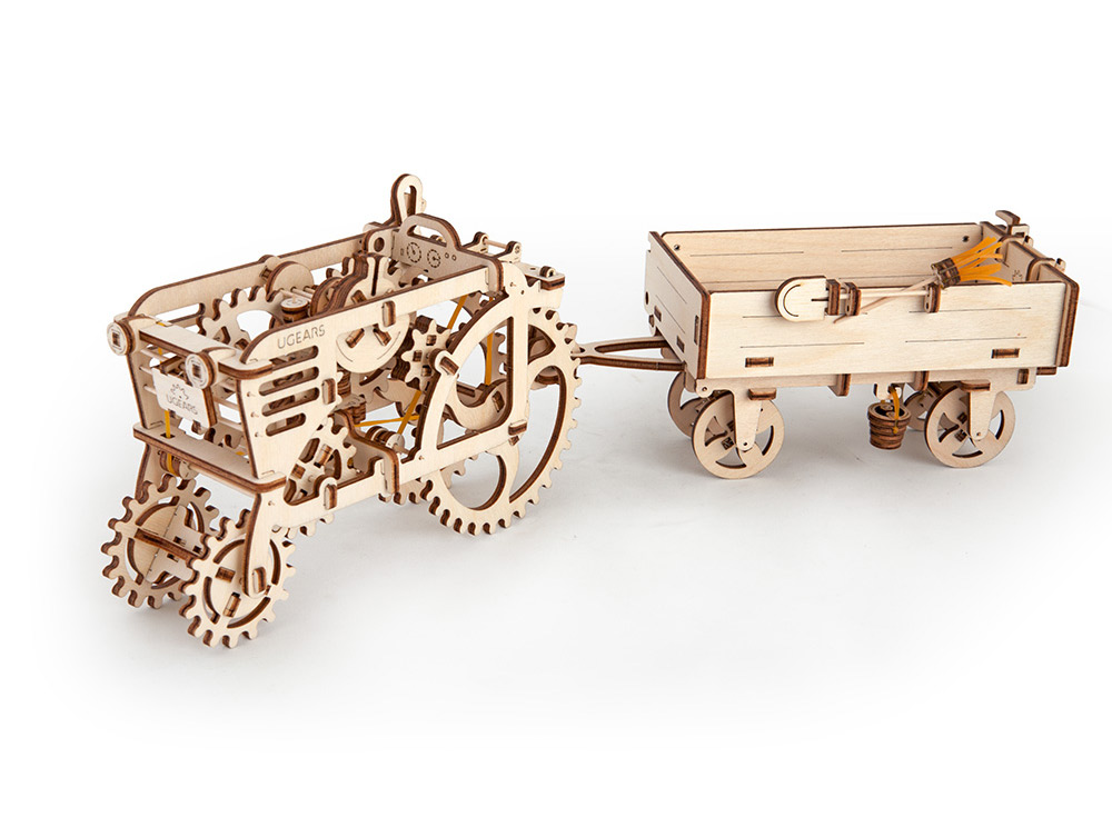 3D-пазл Ugears «Прицеп к трактору»Ugears<br><br><br>Артикул: 70006<br>Размер: 21x10x10 см<br>Расчетное время сборки: 1-2 часа<br>Материал: Дерево<br>Размер упаковки: 37x14x3 см