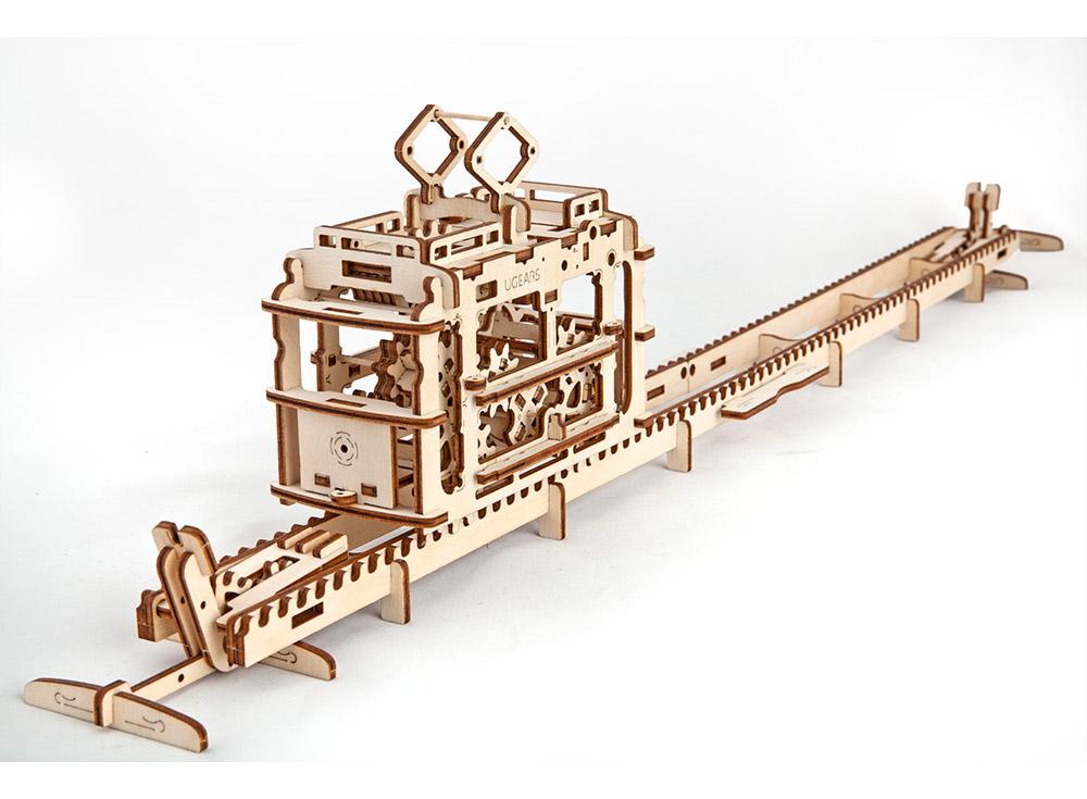 3D-пазл Ugears «Трамвай с рельсами»Ugears<br>Трамвайчик от Ugears покорит любого, не имеет значения возраст или статус - такой 3D-пазл станет украшением праздника в качестве подарка или украшением собственного досуга. Собрать это чудо инженерной мысли совсем несложно, будьте внимательны и следуйт...<br><br>Артикул: 70008<br>Размер: 77x16x7 см<br>Расчетное время сборки: 4-5 часа<br>Материал: Дерево<br>Размер упаковки: 37x17x3 см<br>Возраст: от 14 лет