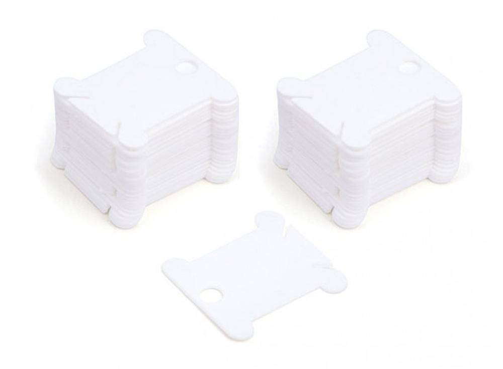 Шпули пластиковые белые (50 шт.)Аксессуары для вышивки<br><br><br>Артикул: 002-Ш<br>Цвет: Белый<br>Количество: 50 шт.