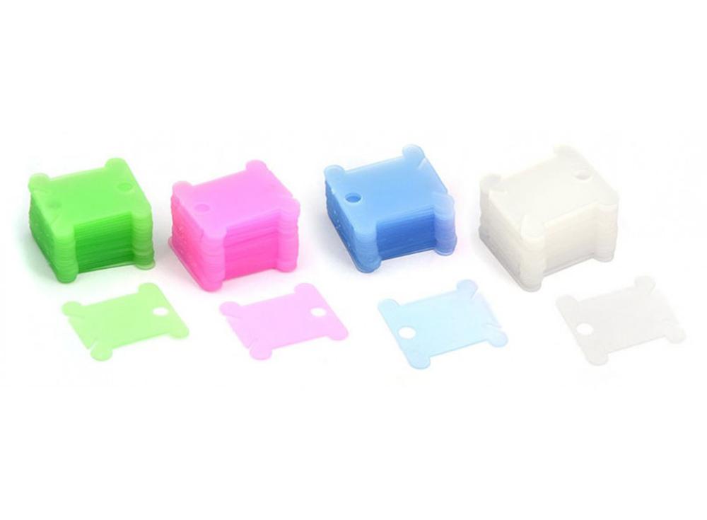 Шпули пластиковые разноцветные (50 шт.)Аксессуары для вышивки<br><br><br>Артикул: 009-Ш<br>Цвет: Розовый, голубой, зеленый, белый<br>Количество: 50 шт.