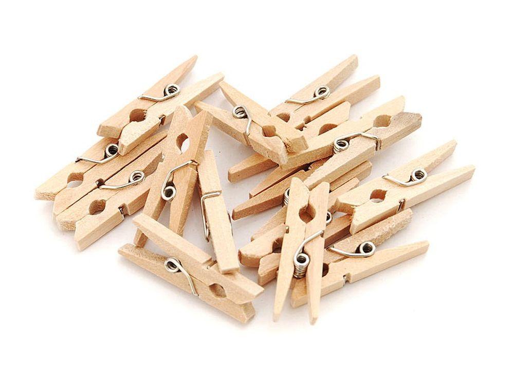 Прищепки декоративныеБумага и материалы для скрапбукинга<br>Новый оригинальный аксессуар для декора и поделок - деревянные прищепки. Небольшие, именно того размера, который идеально подходит для развешивания стикеров, игрушек, других элементов декорирования на веревочках, используемых при оформлении интерьера ...<br><br>Артикул: 860-DB<br>Размер: 3 см<br>Количество: 25 шт.<br>Материал: Дерево