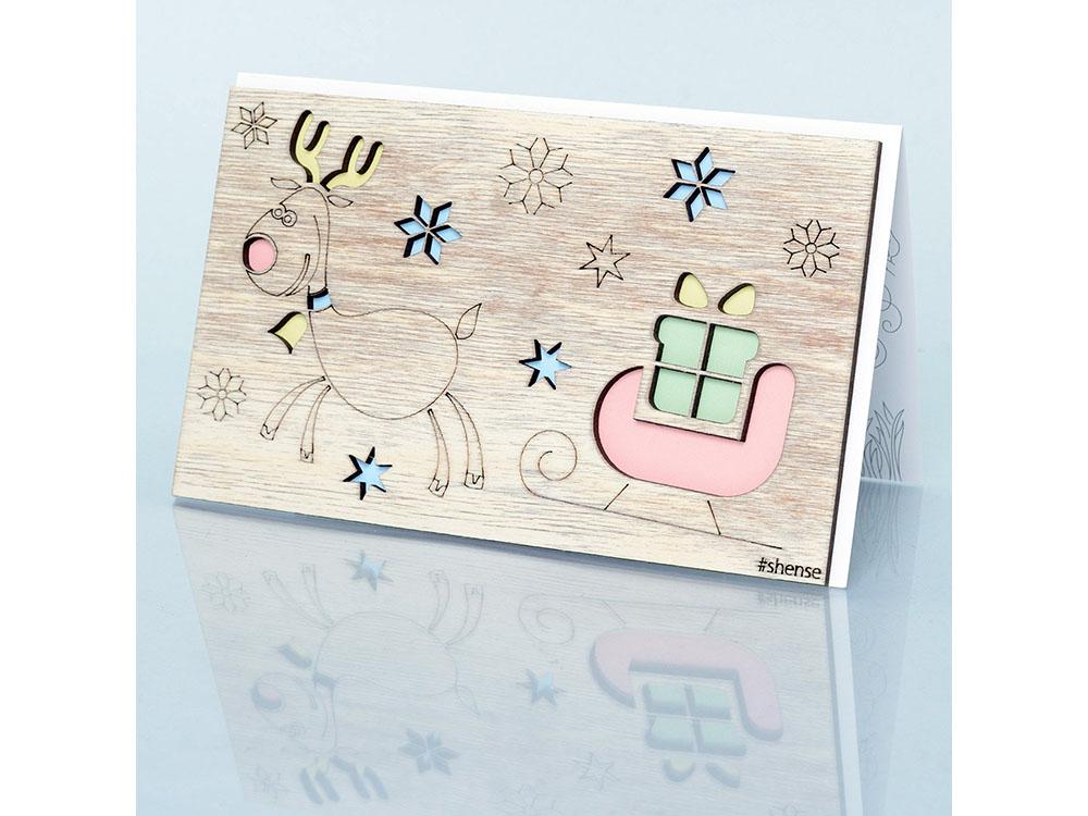 Деревянная открытка «Оленёнок и сани»Деревянные открытки<br>Деревянные открытки и денежные конверты - прекрасная возможность сделать яркий подарок для тех, кто ценит оригинальность, однако не забывает о традициях. И креативность такого презента заключена не только в необычной деревянной первой странице, ведь в...<br><br>Артикул: 2.8.1<br>Размер см: 16x10,6<br>Материал: Дерево, бумага<br>Упаковка: прозрачная полиэтиленовая пленка-конверт