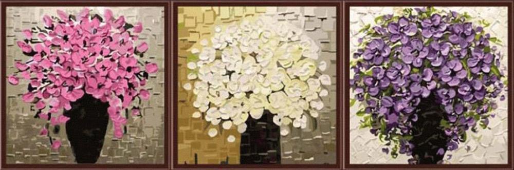 """Картина по номерам «Три букета»Menglei (Premium)<br>Триптих невероятной красоты """"Три букета"""" идеально впишется в любой интерьер. Картина по номерам как будто написана в технике импасто, когда густые краски накладываются на холст, создавая фактурную, рельефную поверхность. Некоторые художники используют для...<br><br>Артикул: MT3065<br>Основа: Холст<br>Сложность: сложные<br>Размер: 3 шт. 50x50 см<br>Количество цветов: 34<br>Техника рисования: Без смешивания красок"""